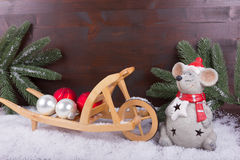 Mouse with Christmas preparations with balls and fir branch Royalty Free Stock Image
