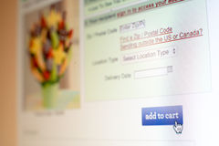 Mouse clicking add to cart button on website Royalty Free Stock Photography