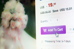 Mouse clicking add to cart button on website. Mouse clicking add to cart button on flowers website while online shopping Stock Image