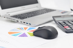 Mouse computer and Financial graphs Royalty Free Stock Photo