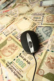 Mouse and currency. A mouse over  Indian currency background Royalty Free Stock Photos