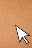 Mouse cursor. On corkboard background Royalty Free Stock Image