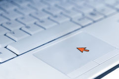 Mouse cursor on laptop touchpad Royalty Free Stock Images