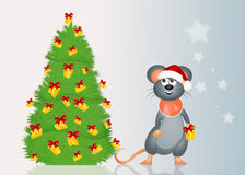 Mouse decorates the Christmas tree with cheese Royalty Free Stock Photo