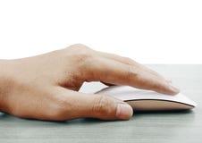 Mouse del calcolatore con la mano fotografia stock