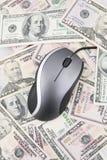 Mouse del calcolatore e banconote degli Stati Uniti Fotografia Stock
