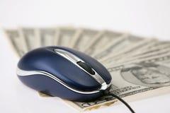 Mouse e soldi del calcolatore Immagine Stock