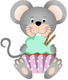 Mouse eating cupcake Stock Photography