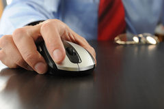 Mouse in hand businessman Stock Photos