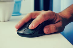 Mouse in hand people are working Royalty Free Stock Photo