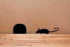 Mouse House in the wall. Silhouette mouse. Little Mouse comes in a hole Stock Photos