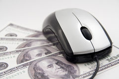 Mouse on hundred dollar bills. Mouse on the hundred dollar bills on a white background Stock Photo