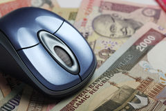 Mouse with indian and iranian currency Stock Images
