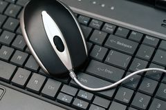 Mouse on keyboard. Wired mouse on a black keyboard stock photography