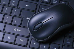Mouse&keyboard. Black mouse on the keyboard Stock Image