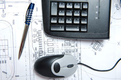 Mouse, keyboard and pen. On a construction plan Stock Photo