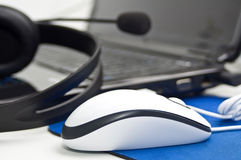 Mouse with laptop and headphones Royalty Free Stock Image