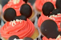 Mouse looking cup cake Royalty Free Stock Photography