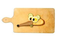 Mouse made with bread, cheese, egg and cucumber on cutting board. Mouse made with slices of bread, cheese, egg, olive and cucumber. Creative and easy way to Royalty Free Stock Photo