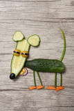 Funny mouse made of cucumber on wooden background. Mouse made with cucumber, carrot, onion, corn, radish, olive. Shot with Canon 5D, ISO 100 on wooden background Royalty Free Stock Photos