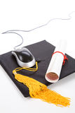 Mouse nero del calcolatore e del Mortarboard immagine stock