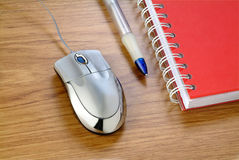 Mouse and note pad. A silver mouse near a pencil and a note pad Stock Photography