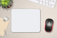 Free Mouse Pad Mockup. White Mat On The Table With Props, Mouse And Keyboard Royalty Free Stock Photography - 134019067