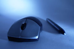 Mouse and pen. Wireless mouse and pen Stock Photos