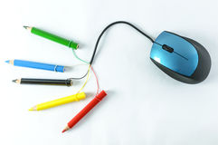 Mouse and pencils. Mouse with broken cable and colored pencils Stock Photo