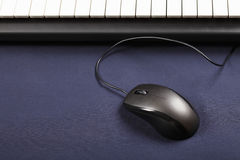 Mouse and piano keyboard Royalty Free Stock Image