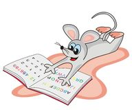 Mouse and primer. Mouse lying on the carpet and learn in school Royalty Free Stock Photo
