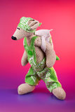 Mouse pupil toy. Wearing green rompers and back pack Royalty Free Stock Photo