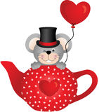 Mouse in red tea pot with heart balloon Royalty Free Stock Photography
