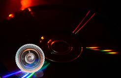 Mouse Scroller Wheel with Music CD Illuminated Lights Stock Photograph. The beautiful unique computer mouse scroll wheel on top of a music CD with illuminated Royalty Free Stock Photo