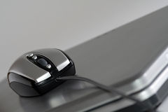 Mouse on a silver laptop. New generation mouse that look like a racing car on a silver laptop stock images