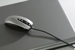 Mouse on a silver laptop Royalty Free Stock Photography