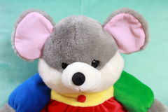 Mouse stuffed toy. Teal reds green grey. Toy Mouse photo Stock Photo
