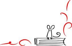 Mouse sul libro Immagine Stock