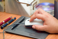Mouse on tablet. A mouse being used over a tablet Stock Photography