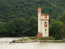 The Mouse Tower. Is a custom tower on a small island in Rhine in Germany. It was built originally by the Romans. Local legend says that the tower was used as a royalty free stock photos