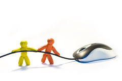 Mouse towing. Two plasticine men towing a mouse by cord Royalty Free Stock Photography