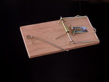Mouse trap. On a plain black background Royalty Free Stock Image