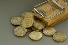 Mouse Trap Catches a British Pound Coin Stock Images