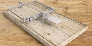 Mouse trap empty on wooden floor. 3d illustration Stock Image