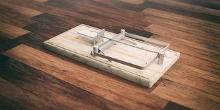 Mouse trap empty on wooden floor. 3d illustration Royalty Free Stock Image