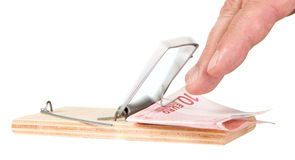 Mouse trap with money Stock Image