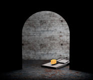 Mouse trap with a piece of cheese looking from hole. 3d Renderin Royalty Free Stock Photography