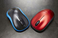 Mouse. Two wireless mouses with blue and red , black background Stock Photos