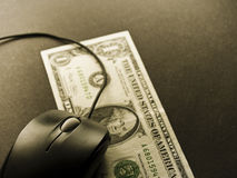 Mouse vs dollar. Close-up image of mouse and one dollar Royalty Free Stock Image