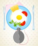 Mouse wants to eat the fried eggs. Little mouse wants to eat the fried eggs from a dish Royalty Free Stock Image